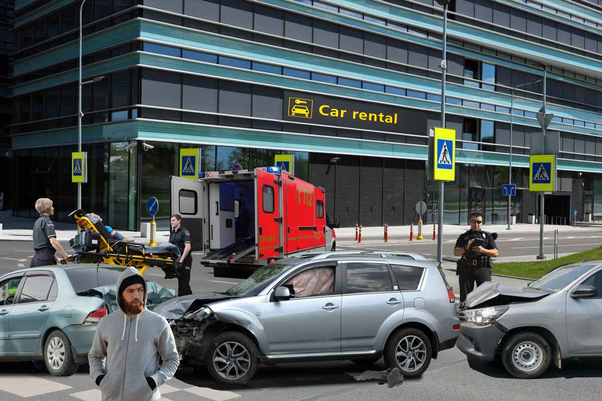 accident scene in front of building with car rental business sign