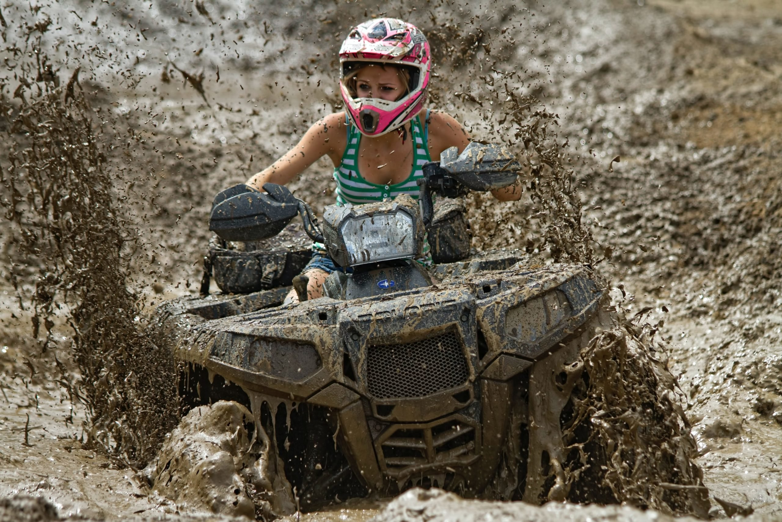 photo of woman on atv
