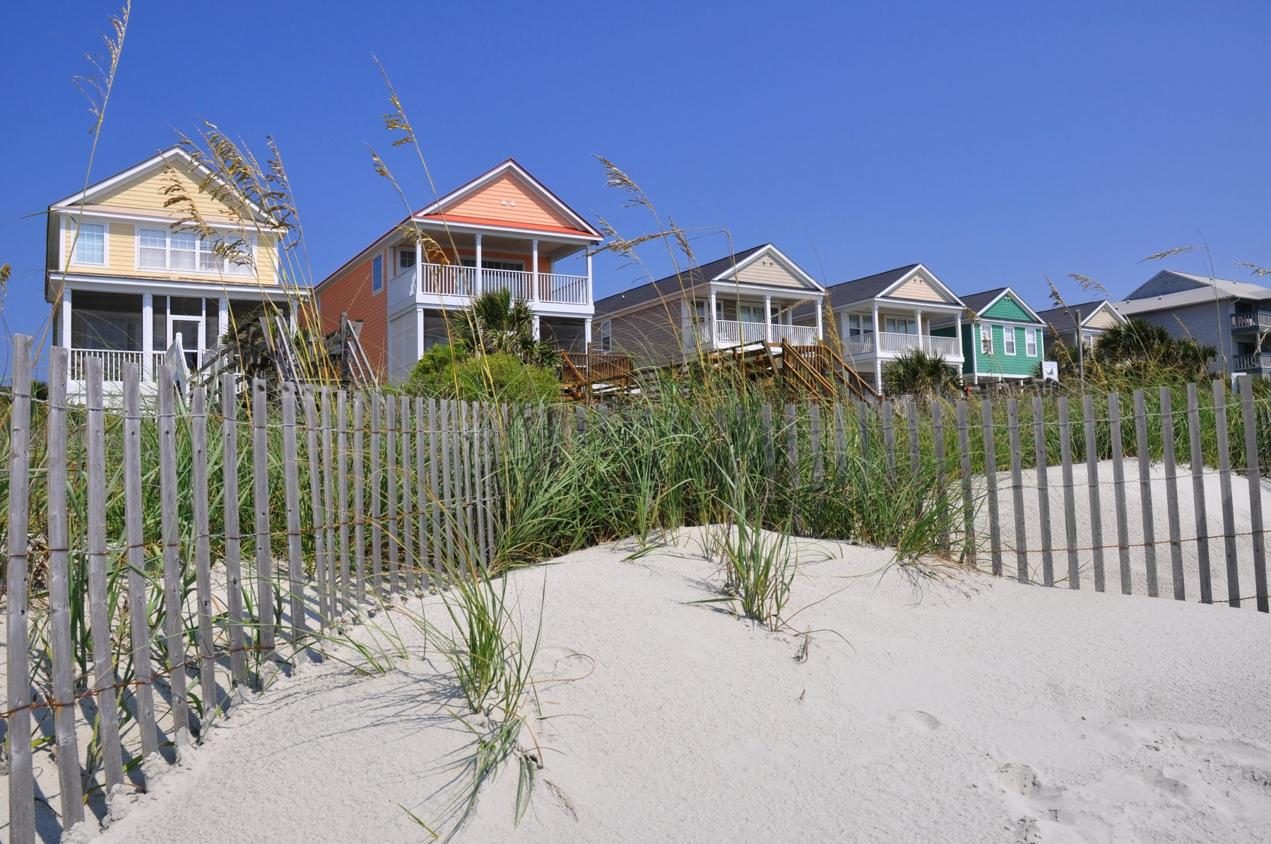 beach homes behind beach dunes