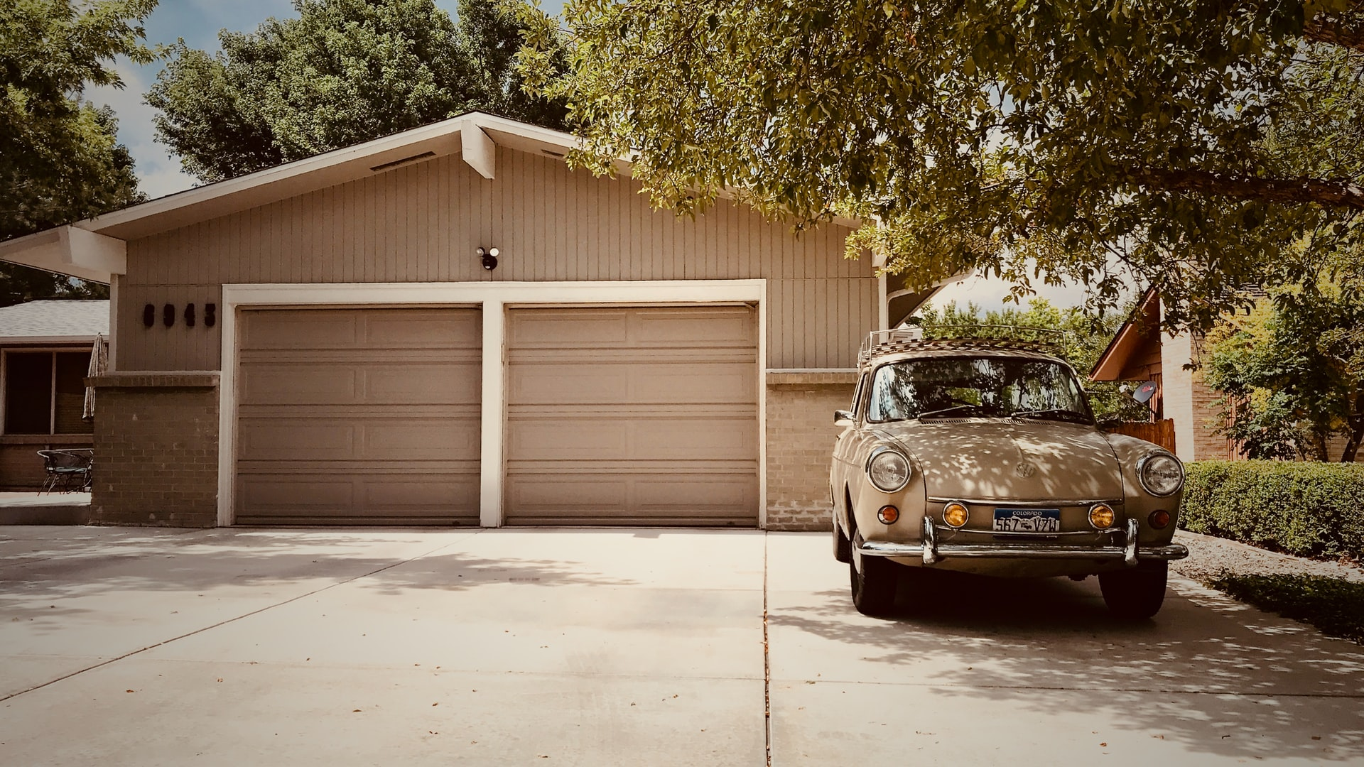 Car sitting on a driveway outside a house